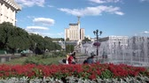 euromaidan : Kyiv, Ukraine, Maidan Nezalezhnosti. Blooming flower beds and fountains on a sunny day Stock Footage