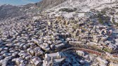 karma : Slow motion drone shot flying backwards in Arachova - Greece