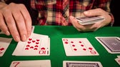 solitaire : Close up of female hands holding cards and playing solitaire Stock Footage