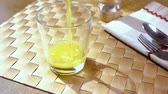 músico : Orange juice pouring into a glass, the morning Breakfast. Slow motion with rotation tracking shot. Stock Footage