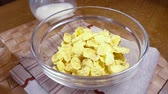 preparation : Crispy yellow corn flakes in the bowl for the morning a delicious breakfast with milk. Slow motion with rotation tracking shot. Stock Footage