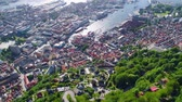 district : Bergen is a city and municipality in Hordaland on the west coast of Norway. Bergen is the second-largest city in Norway. The view from the height of the bird flight. Aerial FPV drone flights.