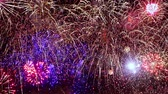 havai fişek gösterisi : New years eve Christmas fireworks with numbers 2019 from volleys, Colorful fireworks exploding in the night sky. Celebrations and events in bright colors. Stok Video