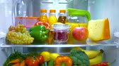 refrigerador : Open refrigerator filled with food. Healthy food. Stock Footage