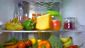 refrigerator : Open refrigerator filled with food. Healthy food. Stock Footage