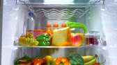 frankfurters : Open refrigerator filled with food. Healthy food. Stock Footage