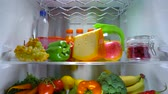 preservar : Open refrigerator filled with food. Healthy food. Stock Footage