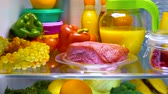 paleo : Fresh raw meat on a shelf open refrigerator