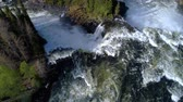 fast river : Ristafallet waterfall in the western part of Jamtland is listed as one of the most beautiful waterfalls in Sweden. Stock Footage