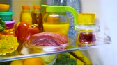 kalori : Fresh raw meat on a shelf open refrigerator