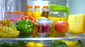 laranjas : Open refrigerator filled with food. Healthy food. Vídeos