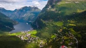 wohnwagen : Geiranger fjord, Beautiful Nature Norway. It is a 15-kilometer (9.3 mi) long branch off of the Sunnylvsfjorden, which is a branch off of the Storfjorden (Great Fjord). Stock Footage