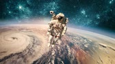 orkan : Astronaut in space. Typhoon over planet Earth.