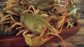armor : Live crayfish on a wooden table close-up