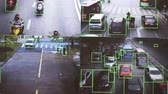 CCTV camera. Real-time tracking of vehicles and people on the street. Authentic pixelated image from a real monitor.