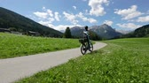 bisiklete binme : Woman on electric eco bike cycling Italy Dolomites Alps