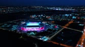 land pollution : Night Aerial view of a freeway intersection and football stadium Spartak Moscow Otkritie Arena