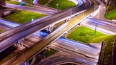 各州間の : Night Timelapse Aerial view of a freeway intersection traffic trails in night Moscow 動画素材