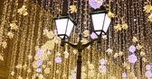 imitation : Street lantern with decorative Christmas garlands. New year and Christmas celebration.