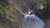 sınır : Latefossen Waterfall Odda Norway. Latefoss is a powerful, twin waterfall.