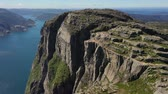 tranqüilidade : Aerial footage Preikestolen or Prekestolen, also known by the English translations of Preachers Pulpit or Pulpit Rock, is a famous tourist attraction in Forsand, Ryfylke, Norway Stock Footage