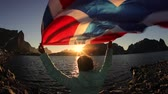 elation : Woman waving the flag of Norway at sunset background Stock Footage