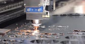 copiadora : CNC Laser cutting of metal modern industrial technology. Laser cutting works by directing the output of a high-power laser through optics. Laser optics and CNC computer numerical control. Stock Footage