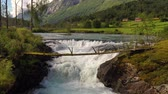 norway fishing : Suspension bridge over the mountain river. Beautiful Nature Norway natural landscape.