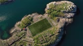 game field : Norway Lofoten Football field stadium in Henningsvaer from above.