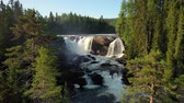 suécia : Ristafallet waterfall in the western part of Jamtland is listed as one of the most beautiful waterfalls in Sweden. Vídeos