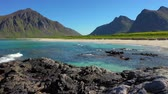 Beach Lofoten islands is an archipelago in the county of Nordland, Norway. Is known for a distinctive scenery with dramatic mountains and peaks, open sea and sheltered bays, beaches Stock Footage