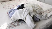 sheets : Pile of Dirty Clothes on Bedspread Stock Footage