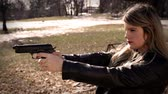 detetive : Female Secret Agent aims pistol at off camera object   Action Movie Shots