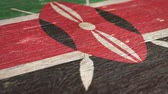 nacionalidad : Flag Of Kenya. Close-Up On Wood, Shallow Depth Of Field, Seamless Loop. High-Quality Animation. Ideal for Your Country  Travel  Political Related Projects. 1080p, 60fps.