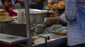 taze : An Indian street food vendor kneads fresh dough