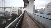 monorail : Odaiba, Japan - 19 February 2019 - Timelapse of fast moving Tokyo monorail runs around Odaiba area to transport passengers from station to station in Odaiba, Japan on February 19, 2019