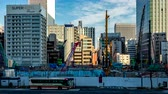 construcción de carreteras : Tokyo, Japan - 23 February 2019 - View of traveling cars run on a street against building construction site in Tokyo, Japan on February 23, 2019
