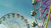 kruhový : Ferris wheels at carnival against blue sky