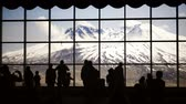Silhouette of tourists viewing Mt. St. Helens from inside Johnston Ridge Observatory.