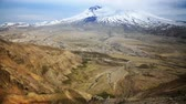 View of the mountain and volcano, Mt. St. Helens and its crater, pan.