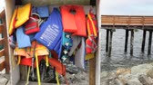 причал : Various life jackets hanging by a pier, Oregon Стоковые видеозаписи