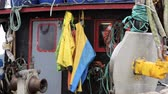 шестерня : Equipment and rain gear hanging on an old fishing boat, Charleston Boat Harbor, Oregon Стоковые видеозаписи