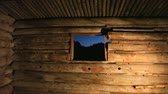 pencereler : View of the Grand Tetons from inside the Cunningham Cabin at night, dolly shot