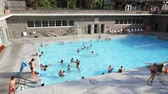 yüzme havuzu : People enjoying the warm waters of the Radium Hot Springs Pool, Kootenay National Park Stok Video