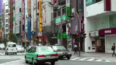 Япония : Traffic and businesses in Shinjuku Tokyo, Japan