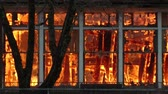 рамка : Fire consumes a building during a controlled burn of an abandoned public school building Стоковые видеозаписи