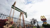 tomada : EDMONTON, ALBERTA _?AUGUST 8, 2010.  Pumpjack located in front of a McDonalds on August 8, 2010 in Edmonton, A.B., Canada. Stock Footage