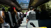 Бразилия : Scene from Countryside Brazil South America Slow still Motion shot zoom Group of Tourists Backpackers on bus