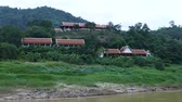 laosz : Scene from Mekong River Laos South East Asia Slow View Motion from boat Countryside rolling hills trees mountains rural