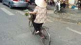 lovaglás : Scene from Hanoi Vietnam Asia Slow Tracking Motion shot of Vietnamese Woman riding traditional bike wearing
